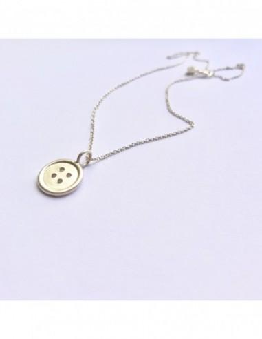Colgante botón de plata con acabado textura de arena